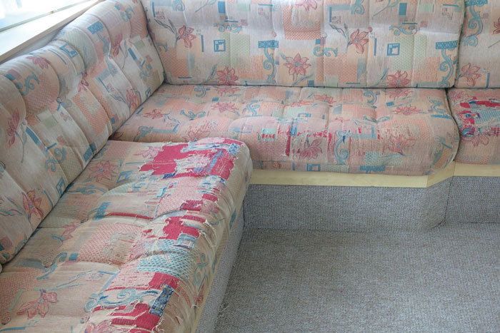 Before - static caravan seat cushions are worn and threadbare