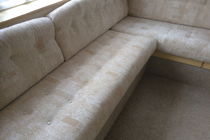 After - the caravan cushions are re-upholstered in a modern fabrics for years more use